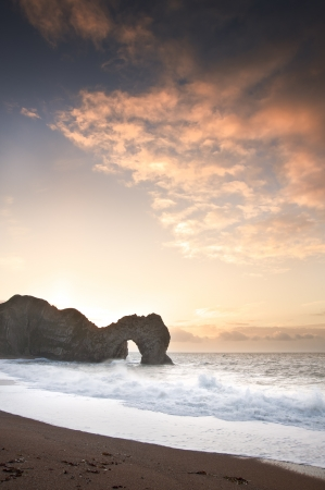 Winter sunrise at Durdle Door on Jurassic Coast in England photo