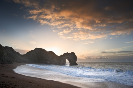 Beautiful sunrise over ocean with rock stack in foreground Stock Photo - 17387526