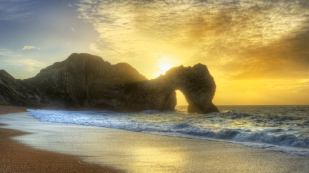 Beautiful sunrise over ocean with rock stack in foreground Stock Photo - 17387527