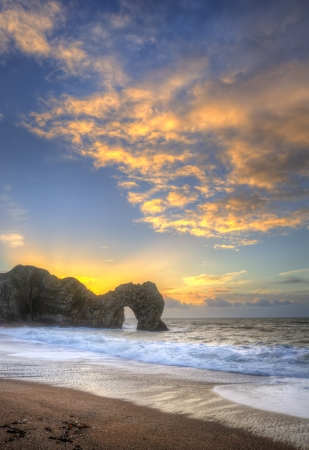Winter sunrise at Durdle Door on Jurassic Coast in England photo