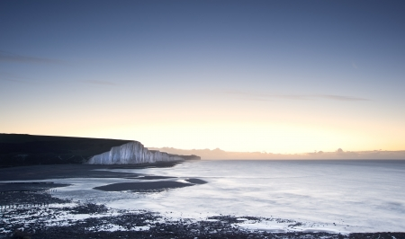 seven sisters: Seven Sisters chalk cliffs in England during Winter sunrise Stock Photo