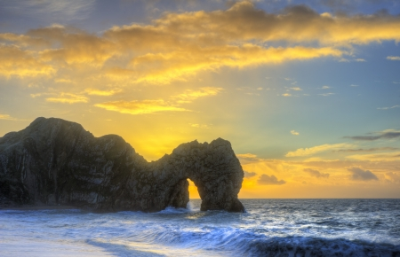 Beautiful sunrise over ocean with rock stack in foreground Stock Photo - 17696560