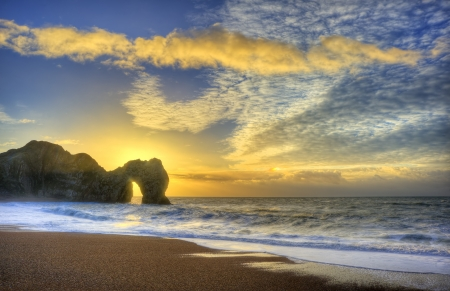 Beautiful sunrise over ocean with rock stack in foreground Stock Photo - 17725919