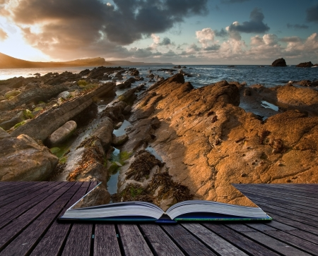 Creative concept image of sunrise landscape on Jurassic Coast in pages of book Stock Photo - 17725732