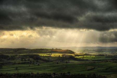 Sunbeams over Big Moor in Peak District in Autumn
