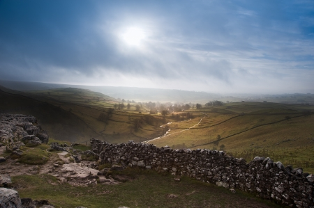 Sunrise over Malham Cove and Dale in Yorkshire Dales National Park with sunlight bursting through mist Stock Photo - 18291014