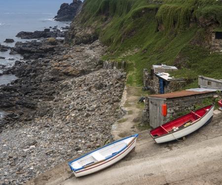slipway: Fishing boats and huts on slipway on shore Stock Photo