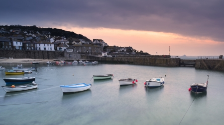 mousehole: Fishing boats in harbour at sunrise long exposure image Stock Photo