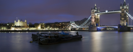 Panorama of Tower of London and Tower Bridge at night photo