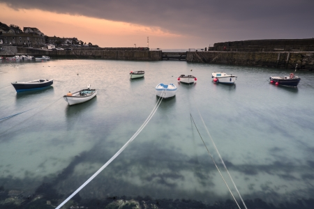 A traditional Cornish fishing village before sunrise in Cornwall England photo