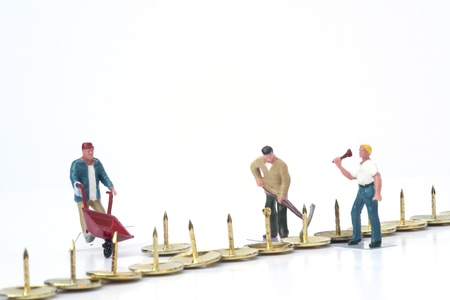 Miniature people teamwork overcoming obstacles business concept photo