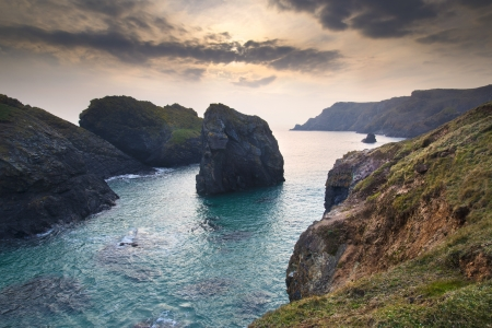 spring tide: Spring sunset at high tide at Kynance Cove