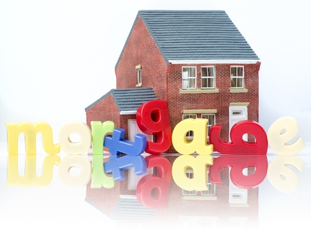 Mortgage house purchase concept with model house and letters photo