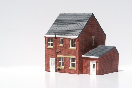 Model of detached house on white background photo