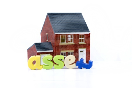 House is an asset concept with model house and letters photo