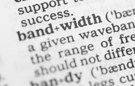 Macro image of dictionary definition of word bandwidth