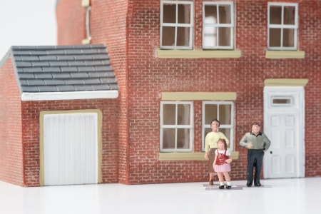 Family home concept with model house and people on white background photo