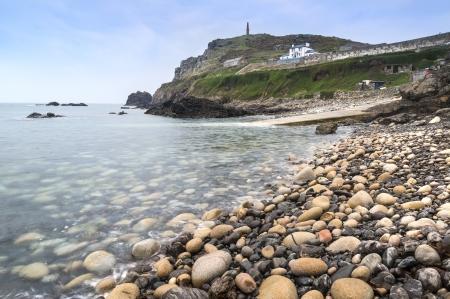 headland: Pebble beach and headland at Cape Cornwall Stock Photo