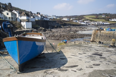 spring tide: Harbour at low tide with fishing boats at Coverack England Stock Photo