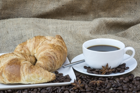 Table setting for continental breakfast of coffee and pastries photo