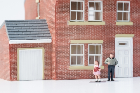 Single parent family concept with model people and house on white background photo