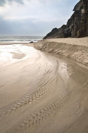 porthcurno: Porthcurno yellow sand beach before sunset Cornwall England Stock Photo