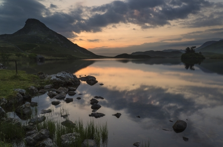 Beautiful sunrise reflected in calm Cregennen Lakes in Snowdonia National Park photo