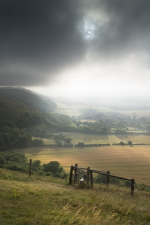 english countryside: English countryside landscape during late Summer afternoon with dramatic sky and lighting
