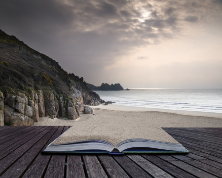 porthcurno: Creative concept pages of book Porthcurno yellow sand beach before sunset Cornwall England