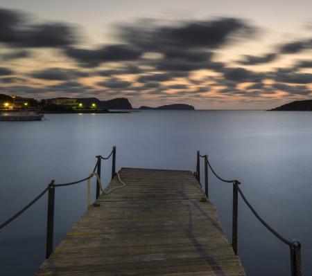 inlet bay: Dawn landscape over jetty on coastline in Mediterranean Sea Stock Photo