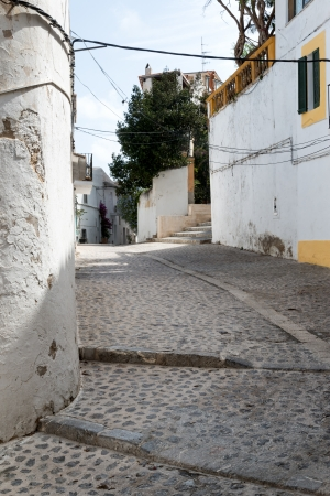 Mediterranean alley way between old houses and buildings photo