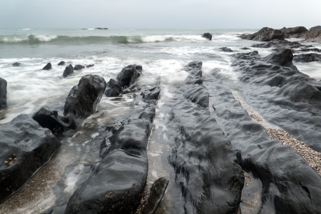 inlet bay: Rugged long exposure landscape seascape of rocky coastline Stock Photo