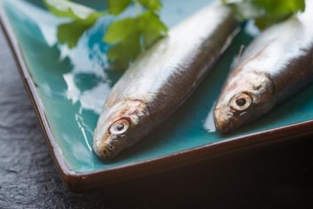 Fresh sprats fish on serving dish Stock Photo - 22821938