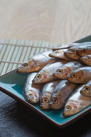 Fresh sprats fish on serving dish Stock Photo - 22985214