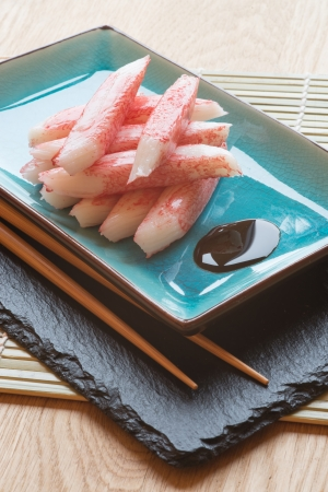 Raw fresh sushi carbsticks on plate with chopsticks Stock Photo - 23178300
