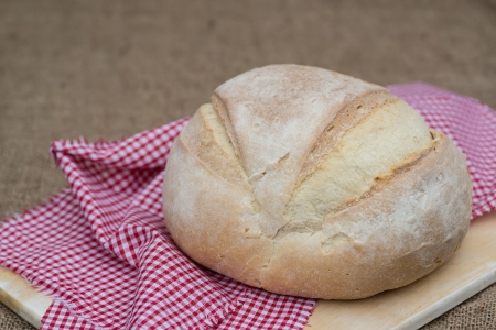 campagne: Freshly baked pain de campagne loaf bread in rustic setting Stock Photo