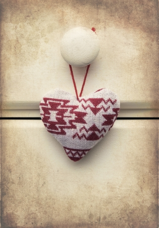 Macro retro cross processed effect image of hand made Christmas heart on wooden background photo
