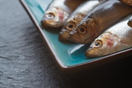 Fresh sprats fish on serving dish Stock Photo - 23721337