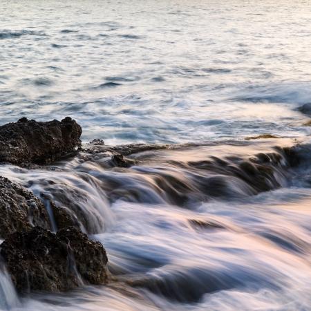 Dawn sunrise landscape over beautiful rocky coastline in Mediterranean Sea photo