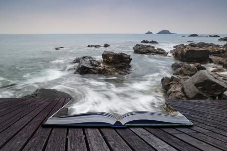 imaginative: Creative concept pages of book Rocky shore and Brisons Rock in distance at Cape Cornwall Stock Photo