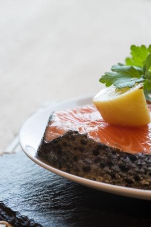 Fresh raw salmon cutlet with lemons and parsley garnish Stock Photo - 23780465