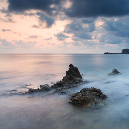 Dawn sunrise landscape over beautiful rocky coastline in Mediterranean Sea photo