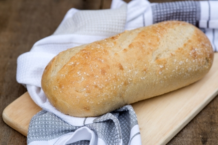 Sourdough loaf of bread in rustic kitched setting Stock Photo - 23780514