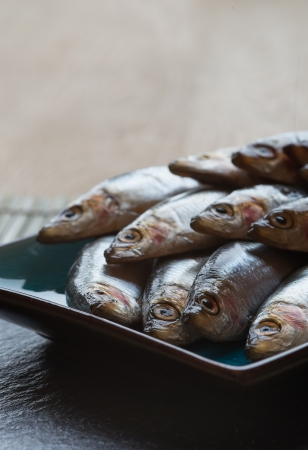 Fresh sprats fish on serving dish Stock Photo - 23957756