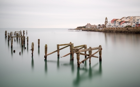 Fine art long exposure landscape of decayed pier photo