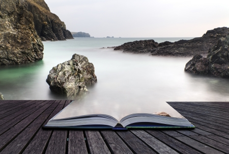 Creative concept pages of book Long exposure Kynance Cove tide photo