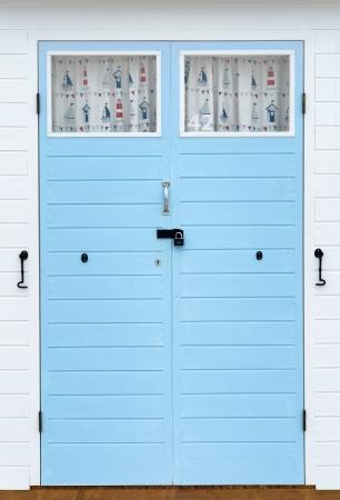 beach hut: Doors on beach hut with nautical theme Stock Photo