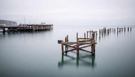 decayed: Fine art long exposure landscape of decayed pier Stock Photo