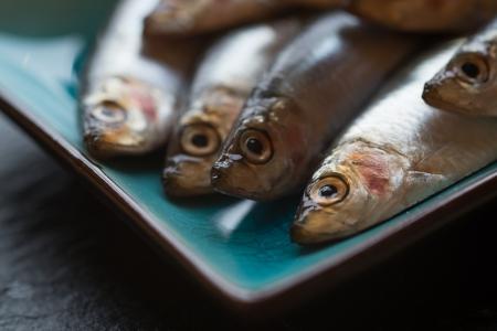 Fresh sprats fish on serving dish Stock Photo - 24263251