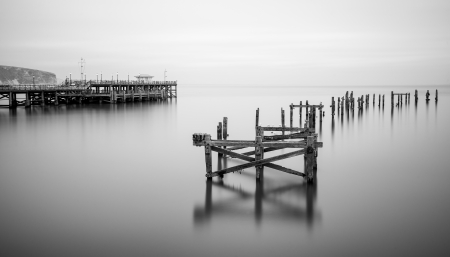 Fine art long exposure landscape of decayed pier Imagens